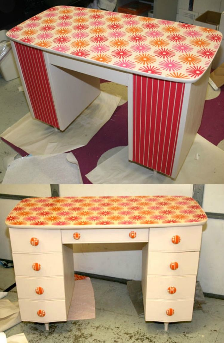 This desk was revamped with fabric and Mod Podge - love how colorful it is now that it's done!