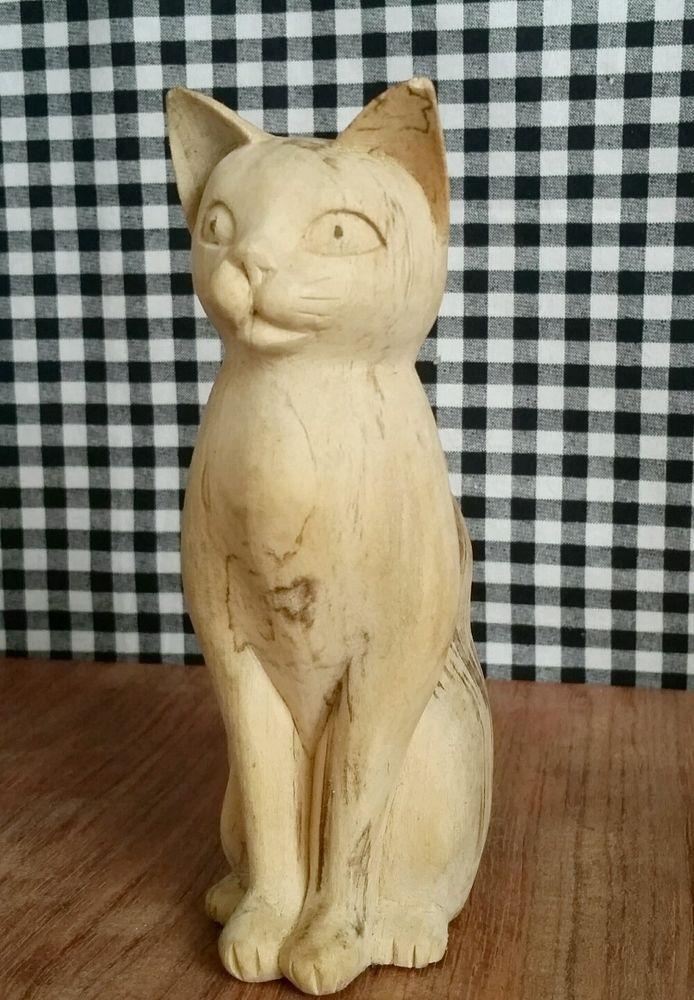 Sitting wood kitty