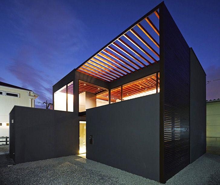 Minimalist Pergola House has an open trellis roof that unifies