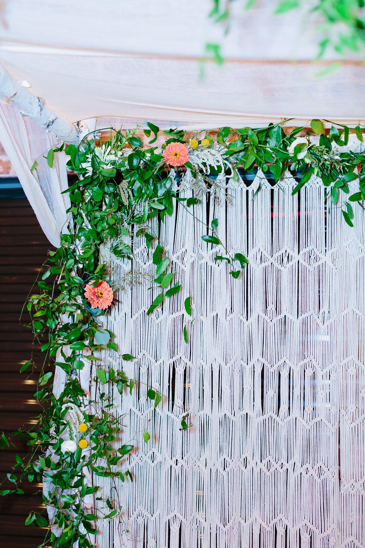 Bohemian Macrame Wedding Ceremony Backdrop With Greenery And Bright Florals Via Birch Brass Vin Ceremony Backdrop Wedding Ceremony Backdrop Macrame Wedding