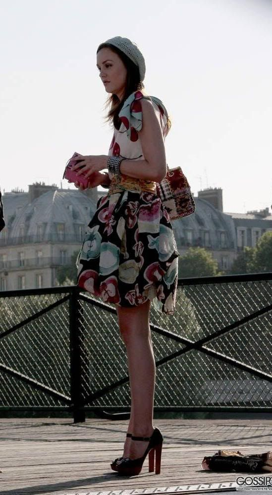 Moschino Spring 2010 dress.  Chanel bag and cuffs.  Christian Louboutin shoes.