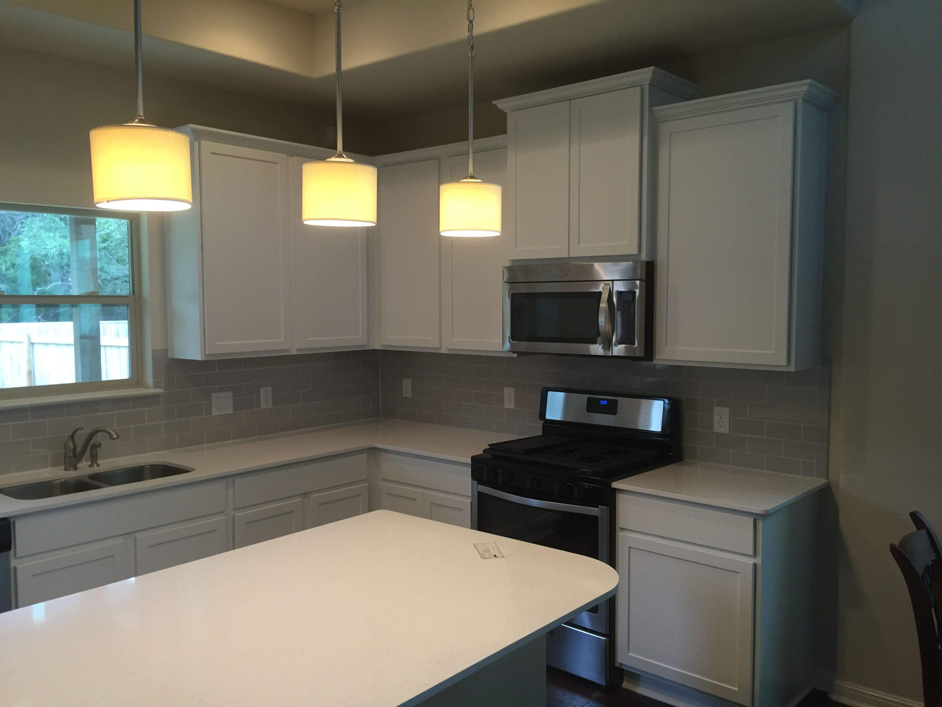 We Painted The Dark Kitchen Cabinets In This Cedar Park Home White To Help Brighten Up The Kitchen After Kitchen Cabinets Dark Kitchen Dark Kitchen Cabinets