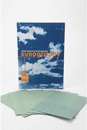 Sunography. You put the cloth out in the sun with objects such as negatives or transparent prints and it makes pictures on the cloth. HOW COOL IS THAT. this is my new favorite toy.