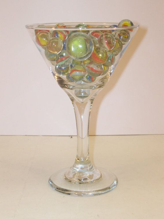 This is a pretty cool looking window sill sun catcher . It's a Libby martini glass with 58 vintage machine made marbles . The marbles alone are worth more than I'm asking for the total display . And as always , FREE SHIPPING to anywhere in the U.S.A. Shipping Weight is 1 lb. 14 oz.  $19.99