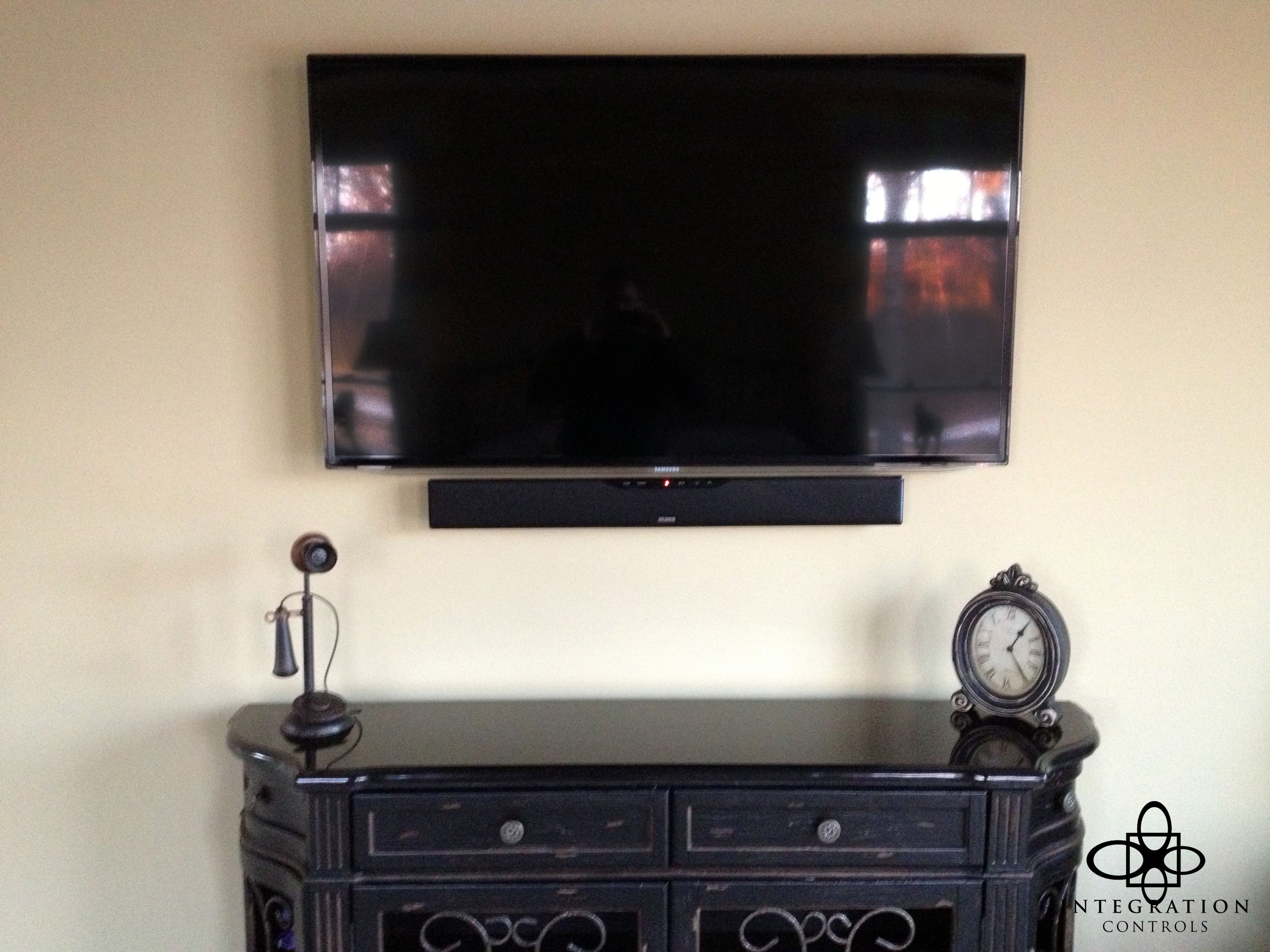 A Simple On Wall Television Installation, Paired With A Small Soundbar,  Offers Better