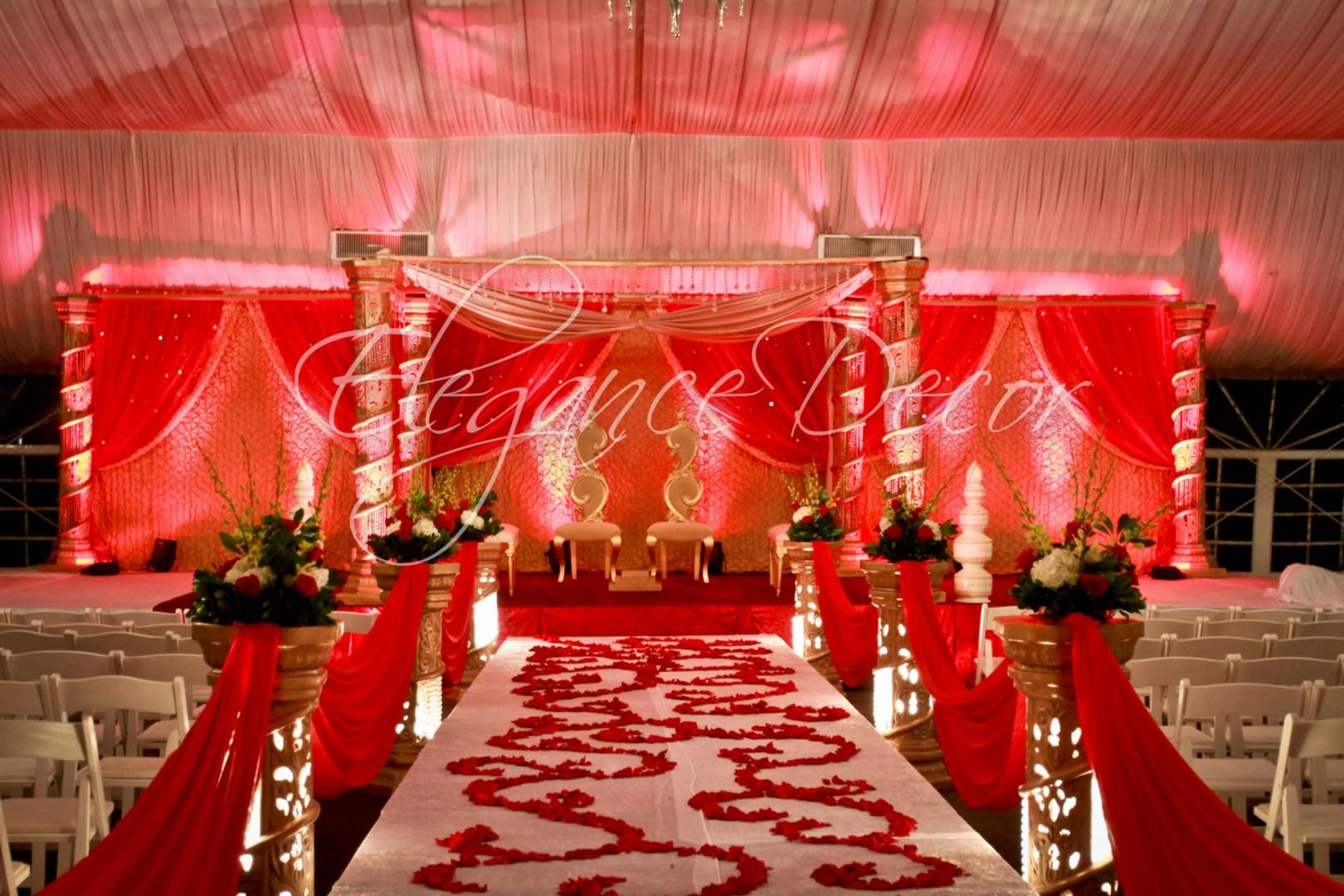 Traditional Gold Carved 6 Pillar Mandap With Red Fabric Drapes And Rose Petal Aisle Designs For