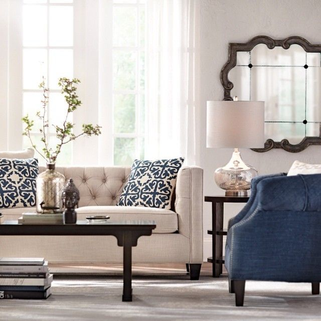 cream and navy with images  wood paneling living room