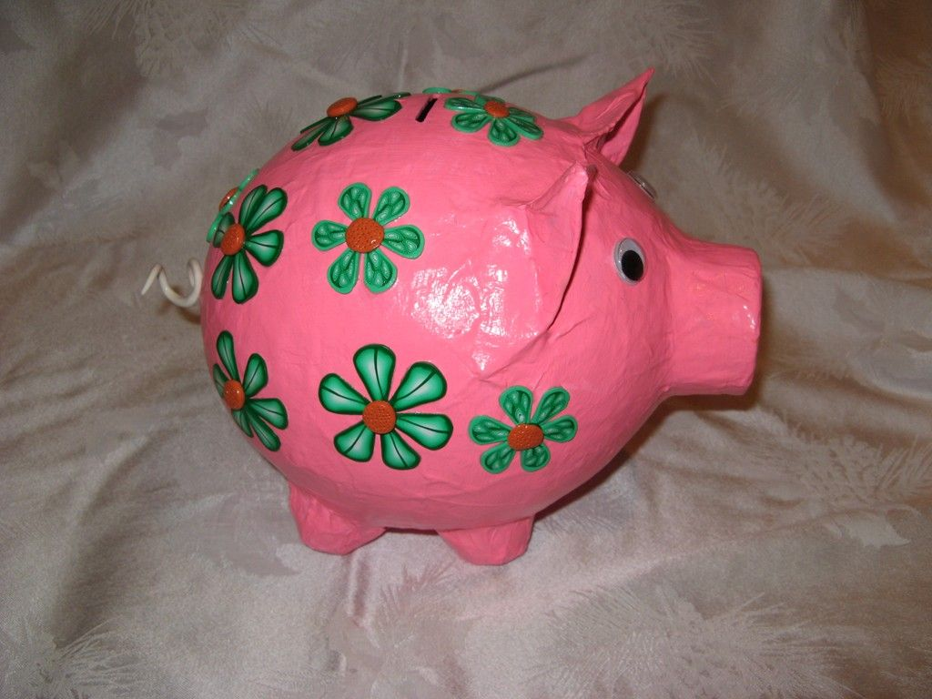 Once you know how to make a paper mache piggy bank with this basic method, you can customise it, too: add a horn and a mane and you have a unicorn; two horns, ears and black and white spots make a cow; and swapping the nose for long ears and a fluffy white pom-pom tail makes a rabbit.