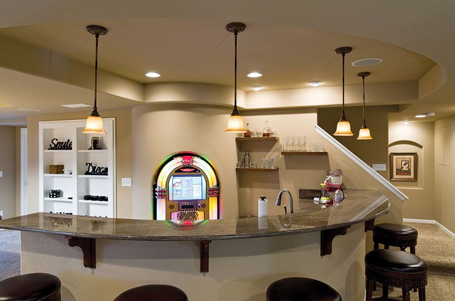 The Basement Wet Bar Is Curved Following The Shape Of The Rounded