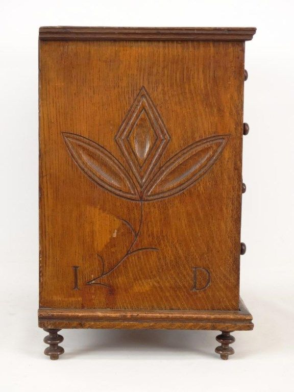"19th c. Penna. miniature chest of drawers. Walnut with pine secondary woods. Carved with hex, pinwheel, florals and geometrics. Dated ""1850"", initialed "" I D"". Dovetailed case, orig. stain and varnish. 16 1/2"" x 11 1/2"" x 18"" Ht.."