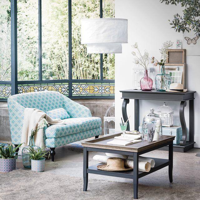 o sofá com padrão e na cor azul resultou muito bem