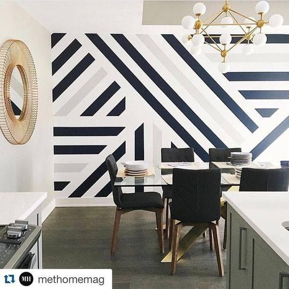 Contemporary black and white panelling to break up the main room