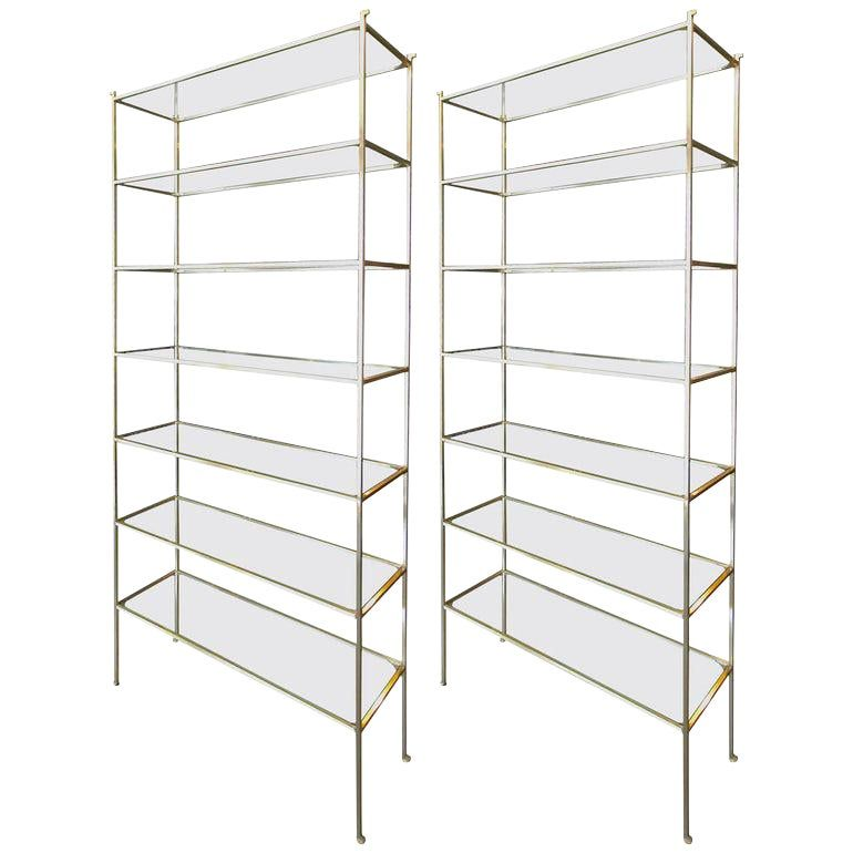 Pair of tall brassetageres with seven glass shelves.  Can be made in custom size.  Priced individually.  C-105