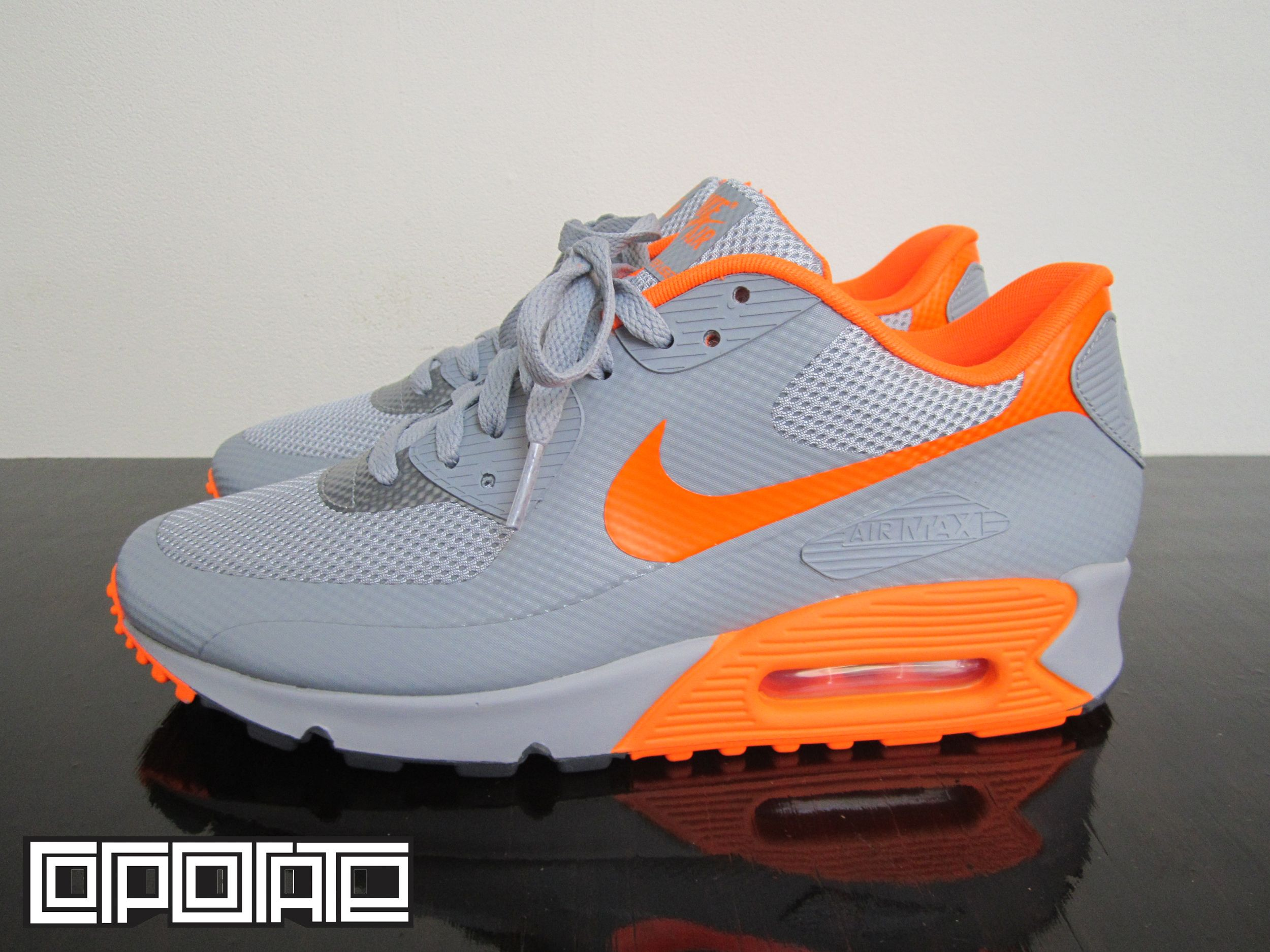 The latest Nike Air Max 90 Hyperfuse takes on a summer look with the use of  Grey/Orange with Hyperfuse panels and mesh.