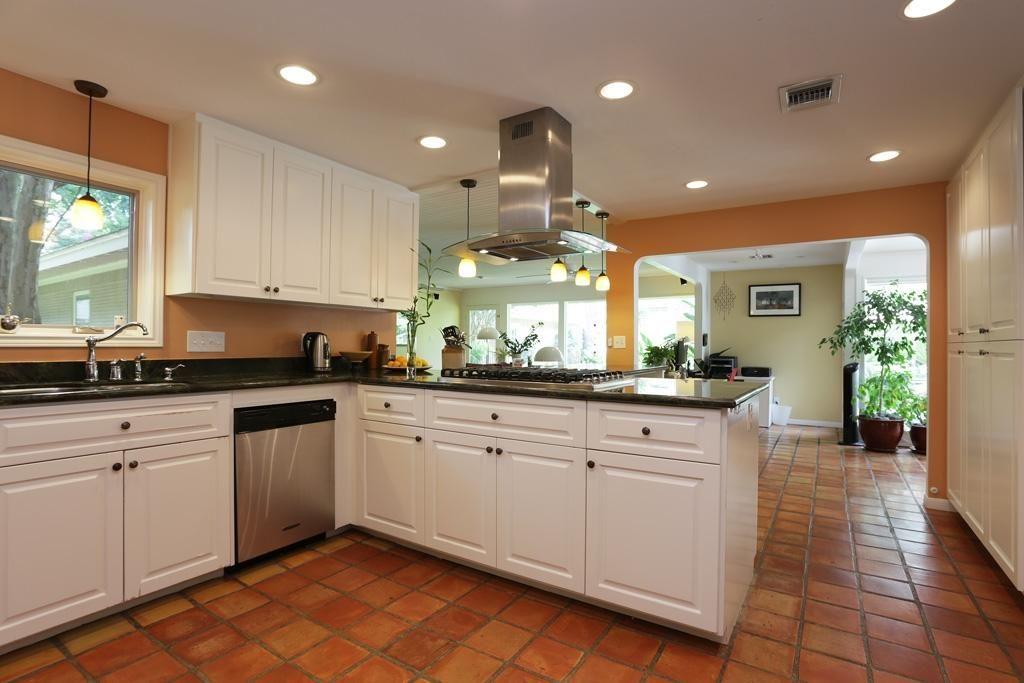 Kitchen Tile Flooring White Cabinets: DESIGNER PENDANT LIGHTING, CUSTOM CABINETRY, A STAINLESS