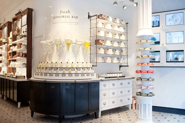 Fresh, New York. This beauty store uses unique fixtures to create an alchemy feel and image within the store. Soaps and a make-your-own fragrance center are pictured. From DDI.