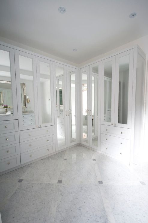 This Beautiful White Walk In Closet Features Marble Floor