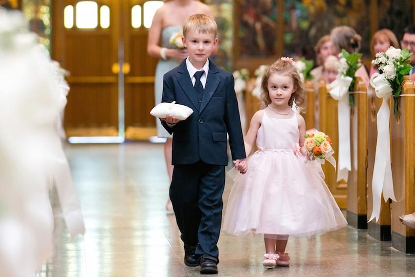 The ring bearer and flower girl taking their job seriously! http://bit.ly/1V8RlrF  (Cassi Claire Photography)