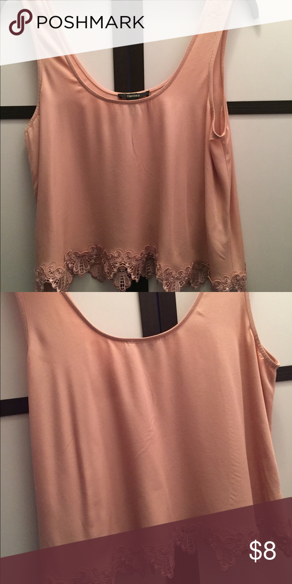 Tank top This is a salmon colored tank top. It is flowy and has a low neck line. Worn only once Forever 21 Tops Tank Tops