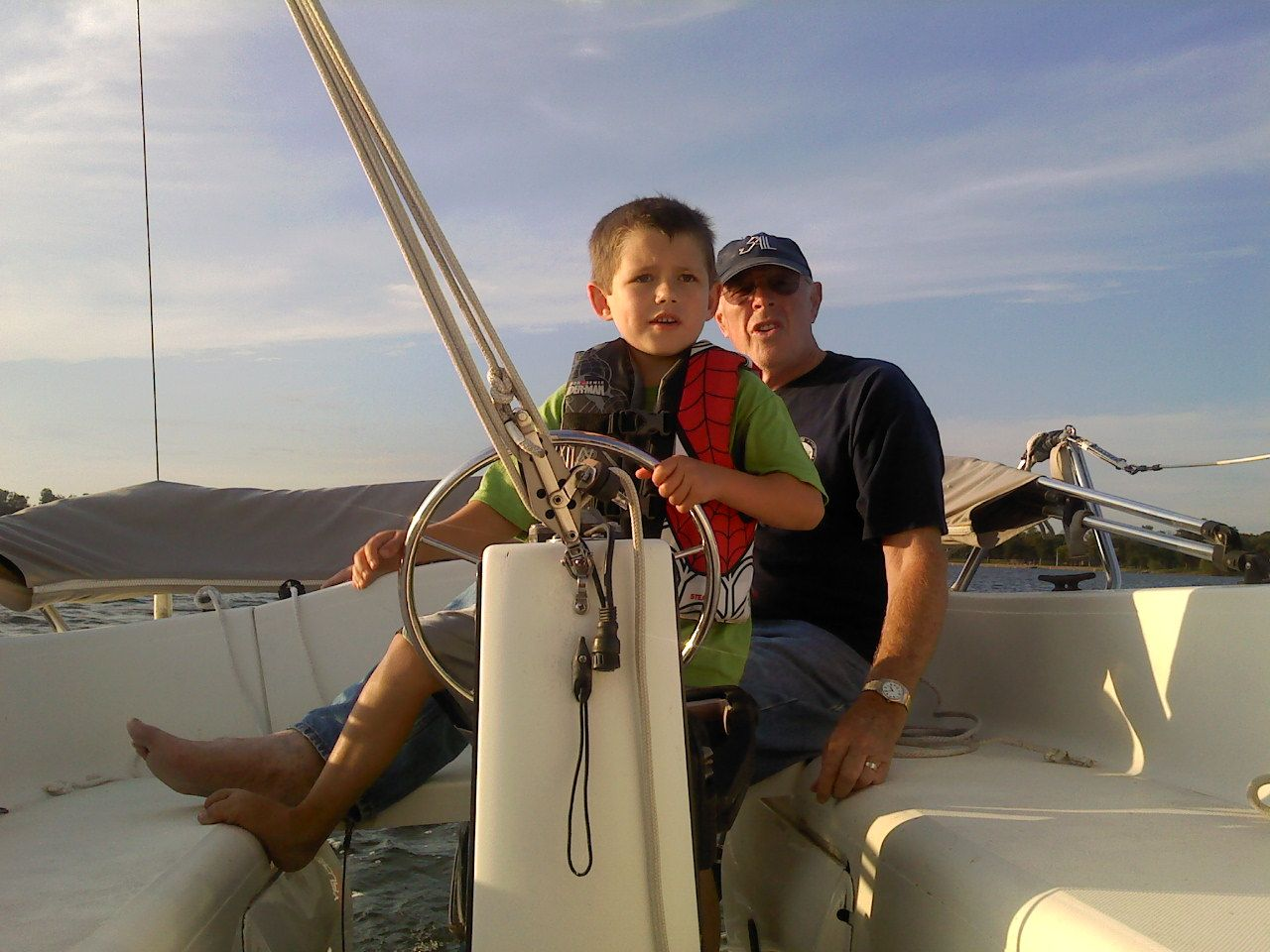 """My turn to be the Captain.  Grandpa, see if I'm doing this right!"""