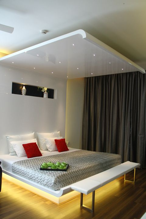 Master bedroom- the extended bed to the ceiling the ...