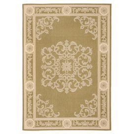 Indoor/outdoor rug with a scrolling motif.   Product: RugConstruction Material: PolypropyleneColor: Olive and naturalFeatures: Machine madeNote: Please be aware that actual colors may vary from those shown on your screen. Accent rugs may also not show the entire pattern that the corresponding area rugs have.