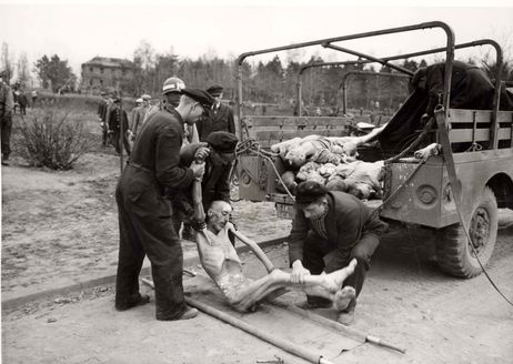 Nordhausen, Germany, April 1945, German citizens loading corpses onto a truck.