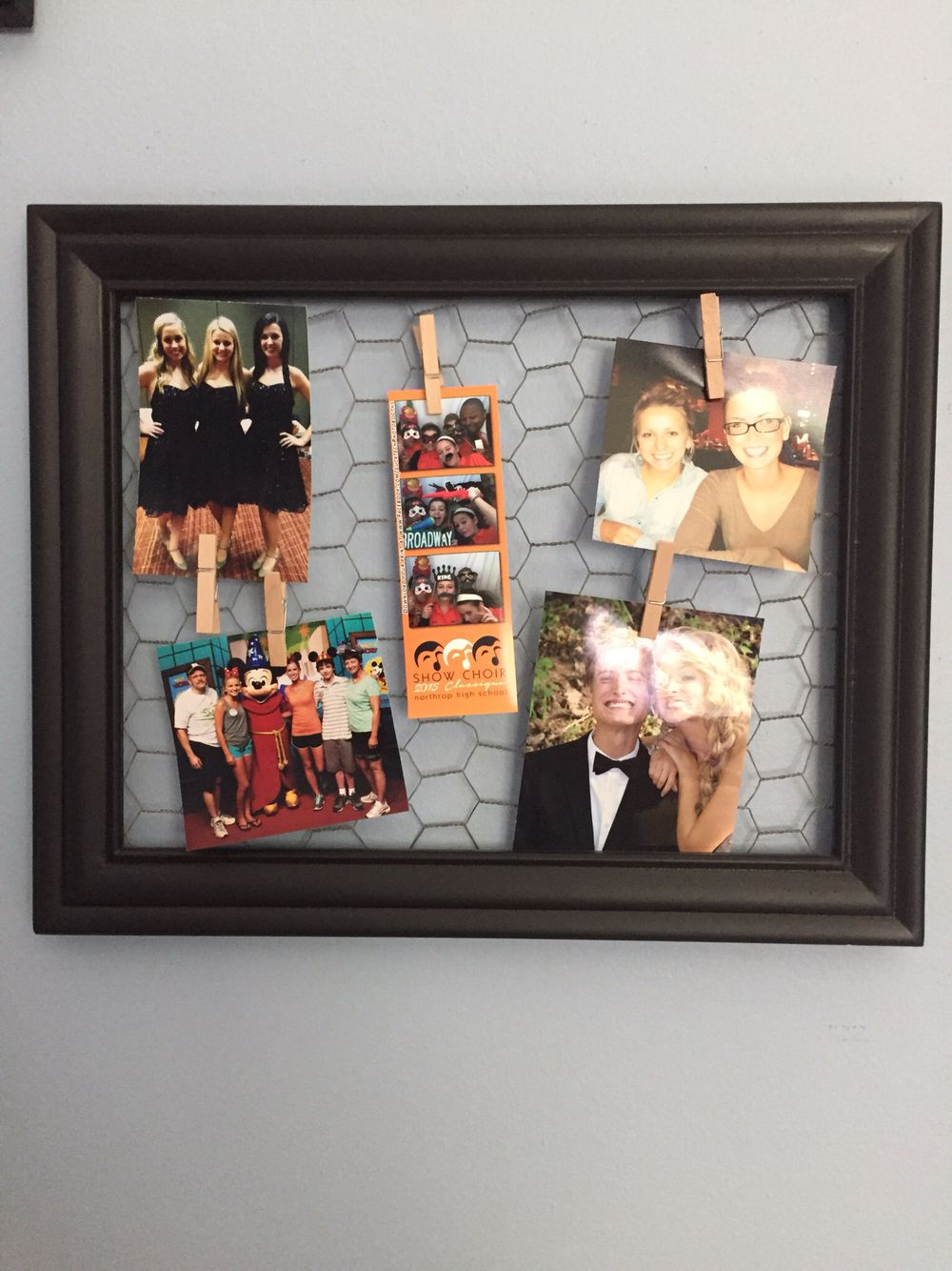 Place chicken wire behind an old frame & hang pictures with mini ...