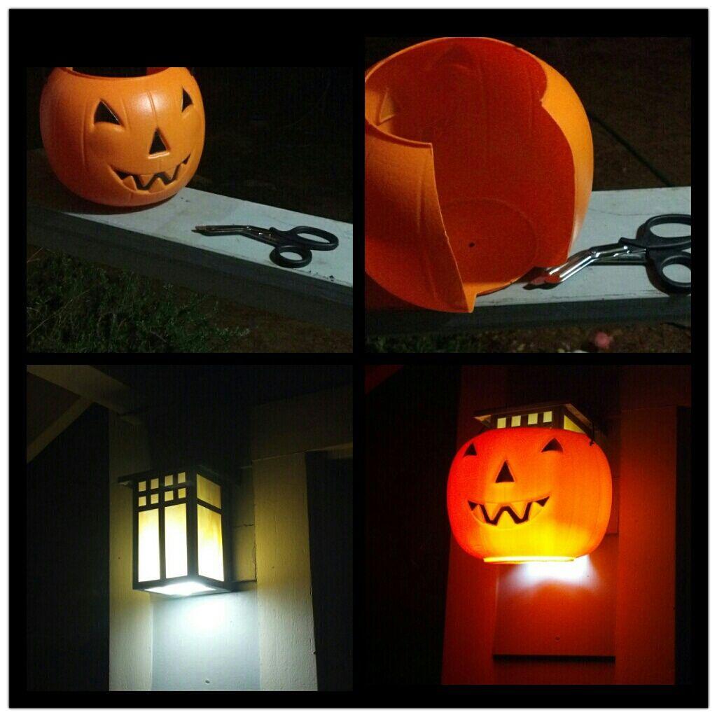 slip a dollar store jack o lantern bucket around porch light diy jack o lantern porch light easy and cheap halloween outside decor