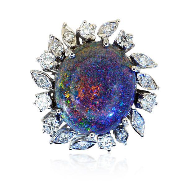 Quirlige und extravagante Energien! Gezähmt auf elegante Art demonstrieren sie Schönheit auf diesem Diamantring mit schwarzem Boulderopal und 0,74ct Diamanten #geschenk #weihnachten #vintage #schmuck #jewels https://www.schmuck-boerse.com/ring/241/detail.htm