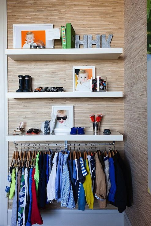 Modern Boyu0027s Closet Design With Raffia Wallpaper Framing Stacked Modern  Floating Shelves And Clothes Rod.