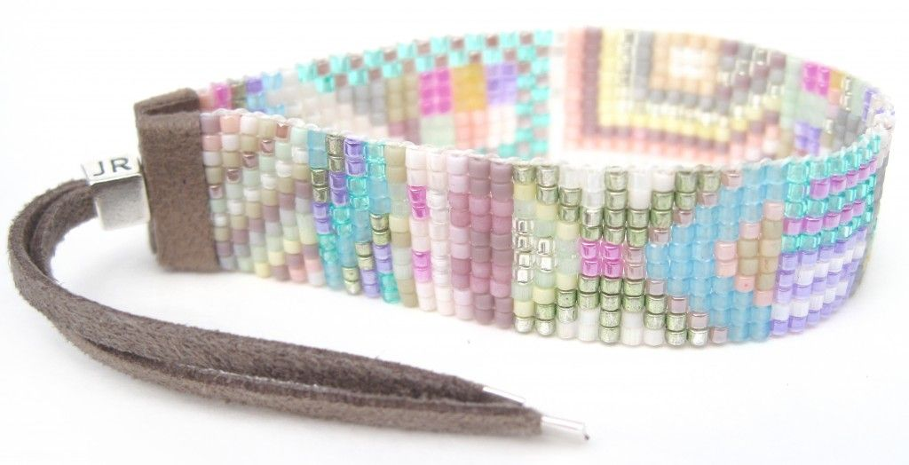 """Julie Rofman handwoven beaded bracelet with sterling silver clasp and tassel ends. 5/8"""" width."""