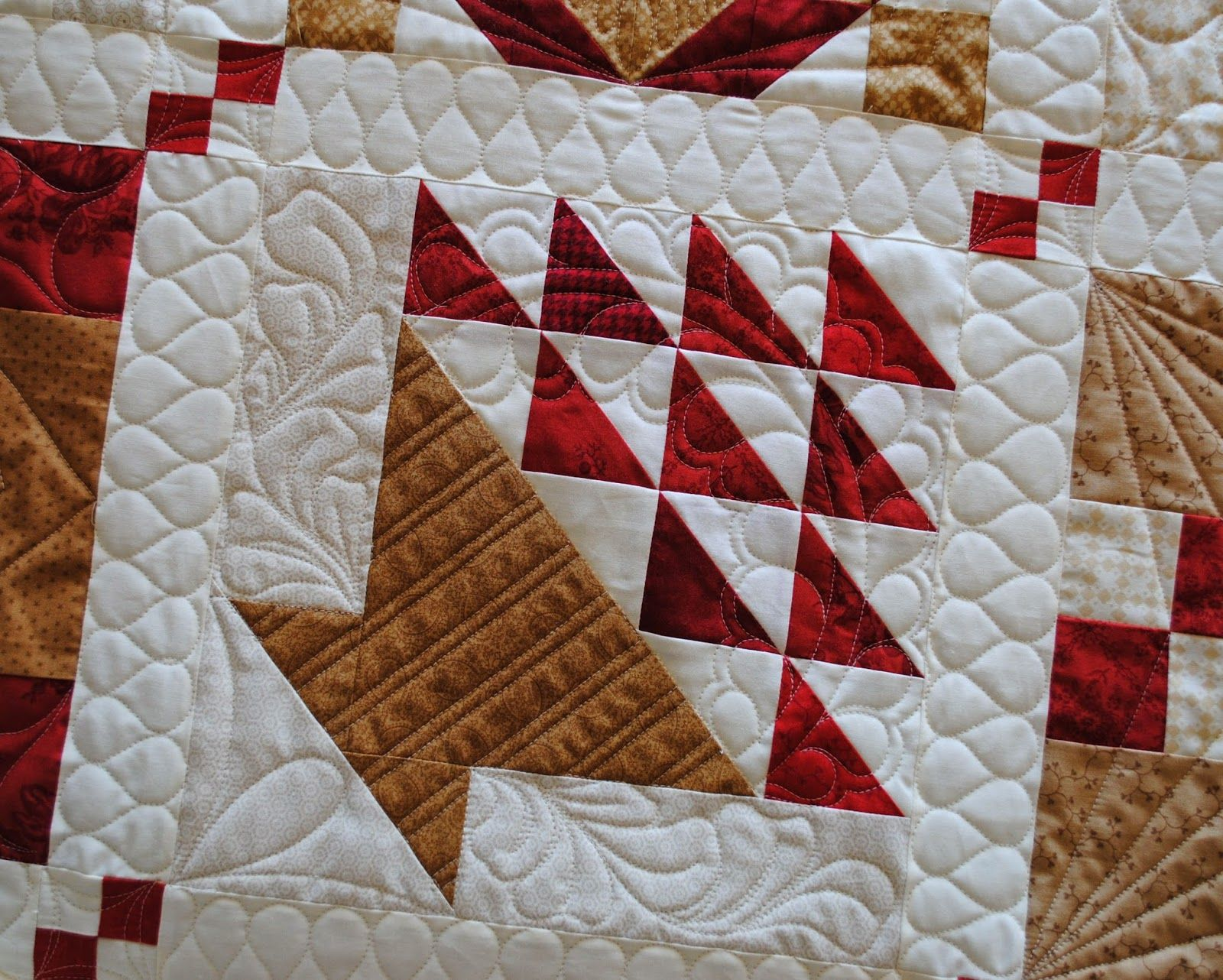 quilting it love the basket design difficult to see the