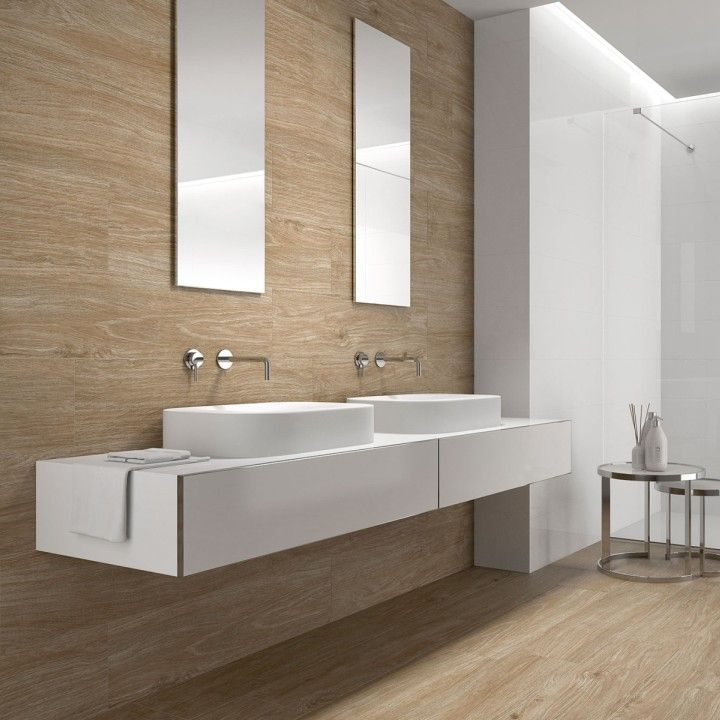The soft tones of the Nature brown porcelain wood effect tiles are ...