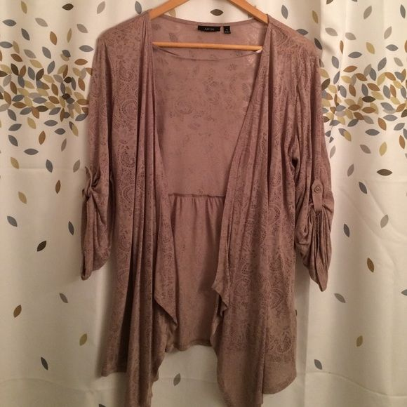 Apt.9 wrap top Very pretty pattern and light weight material. Cute button detail on the sleeves. Like new! Apt. 9 Tops