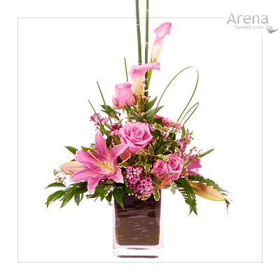 pink flowers in vase table arrangement flowers pink roses pink