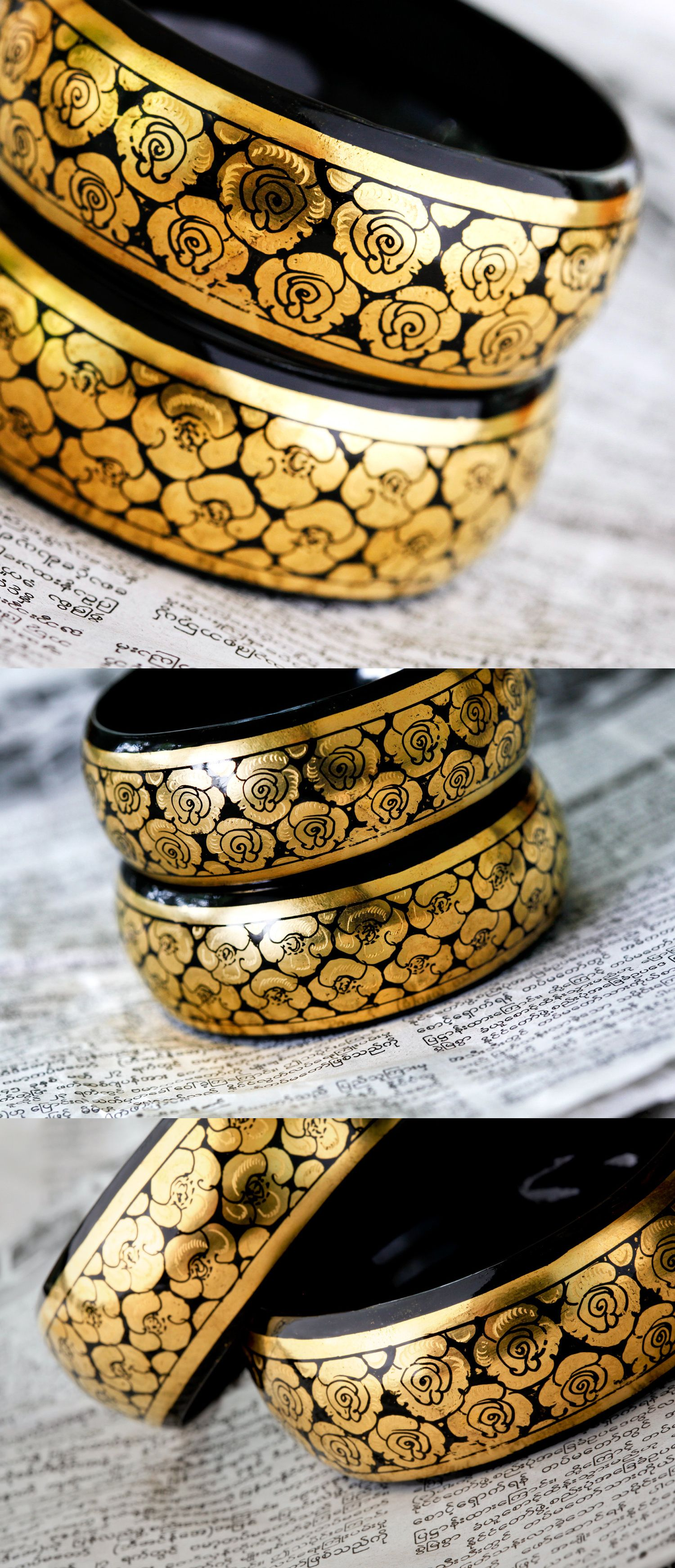 "Delicate hand-etched and hand-painted flowers adorn this pair of black and gold handmade lacquerware bracelets. Each measures 1 1/8"" thick and its inner diameter measures 7 cm, or 2 5/8th inches."