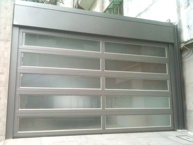 Stainless Steel And Glass Modern Garage Door Called O Leary Stacking Garage  Doors Also Gray Concrete Ground: Exciting Modern Garage Door For Your Home