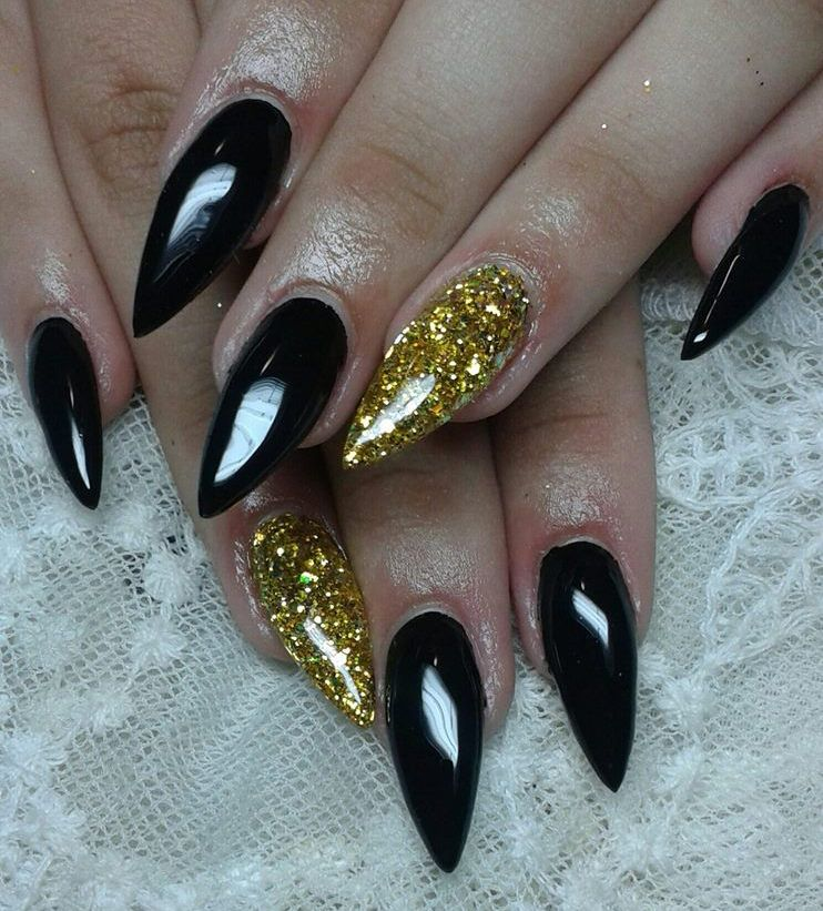 Black spiky nails with tinsel gold make this design simple but still really  elegant. - Black Nail Designs With Rhinestones - Http://www.mycutenails.xyz