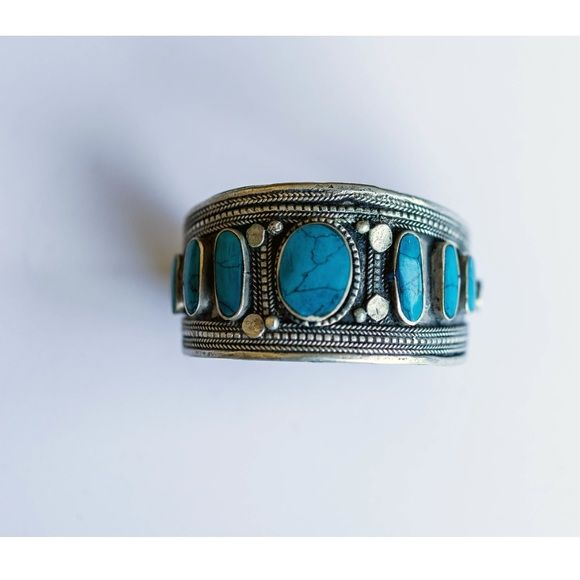 Silver Tribal Cuff with Turquoise Stones Silver Tribal cuff. 100% authentic and genuine stone. Fair Trade/Ethical. All pictures are my own. Ammz Jewelry