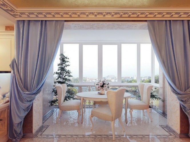 pinned back curtains allow a peek into a breakfast areas Regal