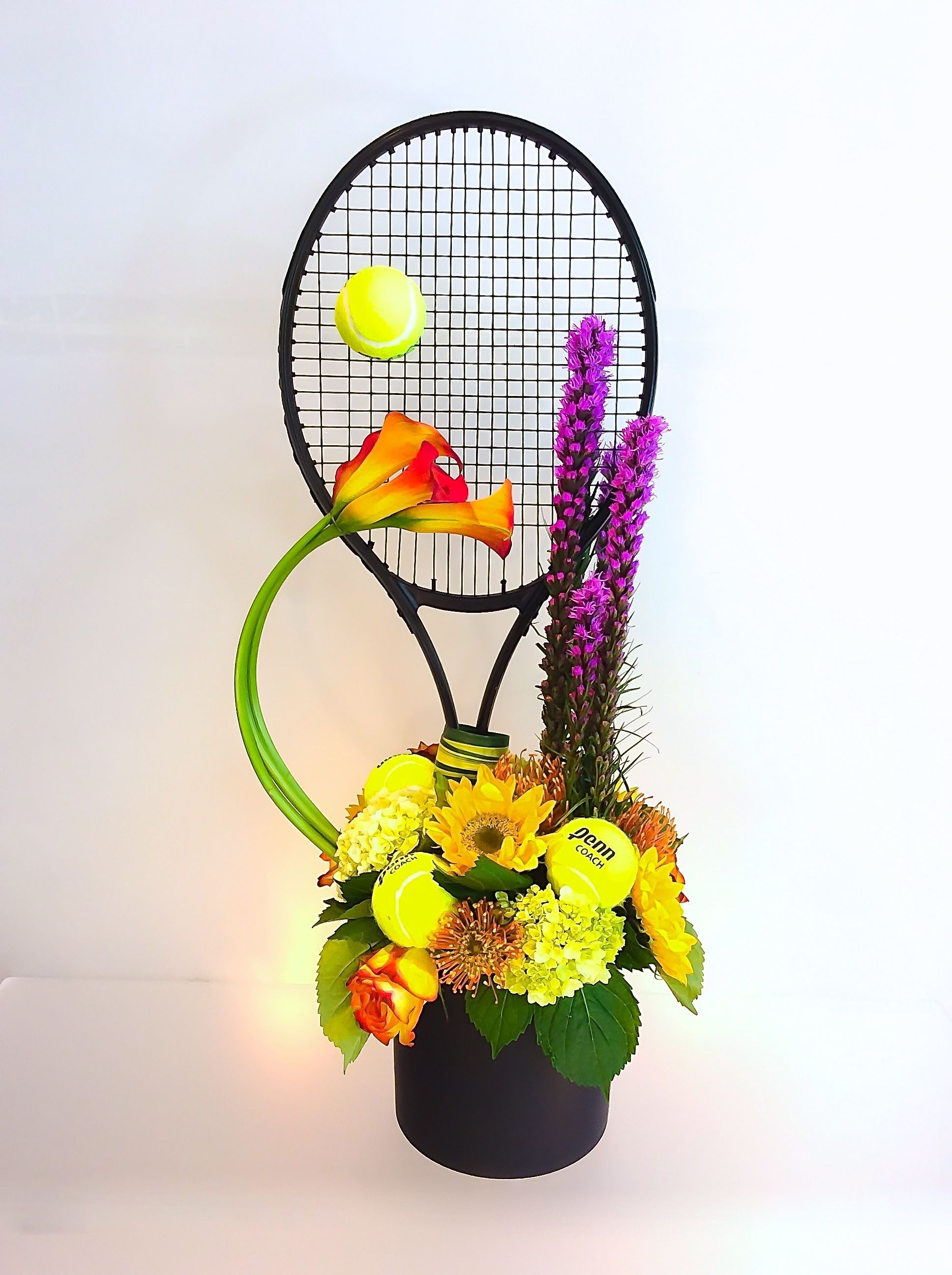 Tennis themed birthday flower arrangement designed by