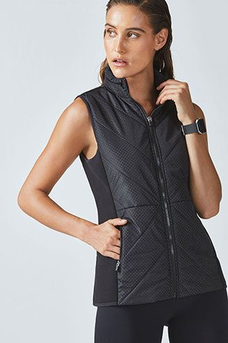Stay warm to the core by layering our puffer vest over your outfit. A perforated design with a contrast lining adds style to this seasonal essential. Water-resistant fabric and a hidden hood in the collar keep you protected against the elements.