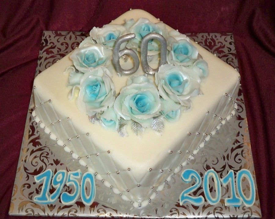 60Th Wedding Anniversary fruit cake with sugar fondant icing and aqua roses with silver number 60 and diamond pattern for a diamond wedding...