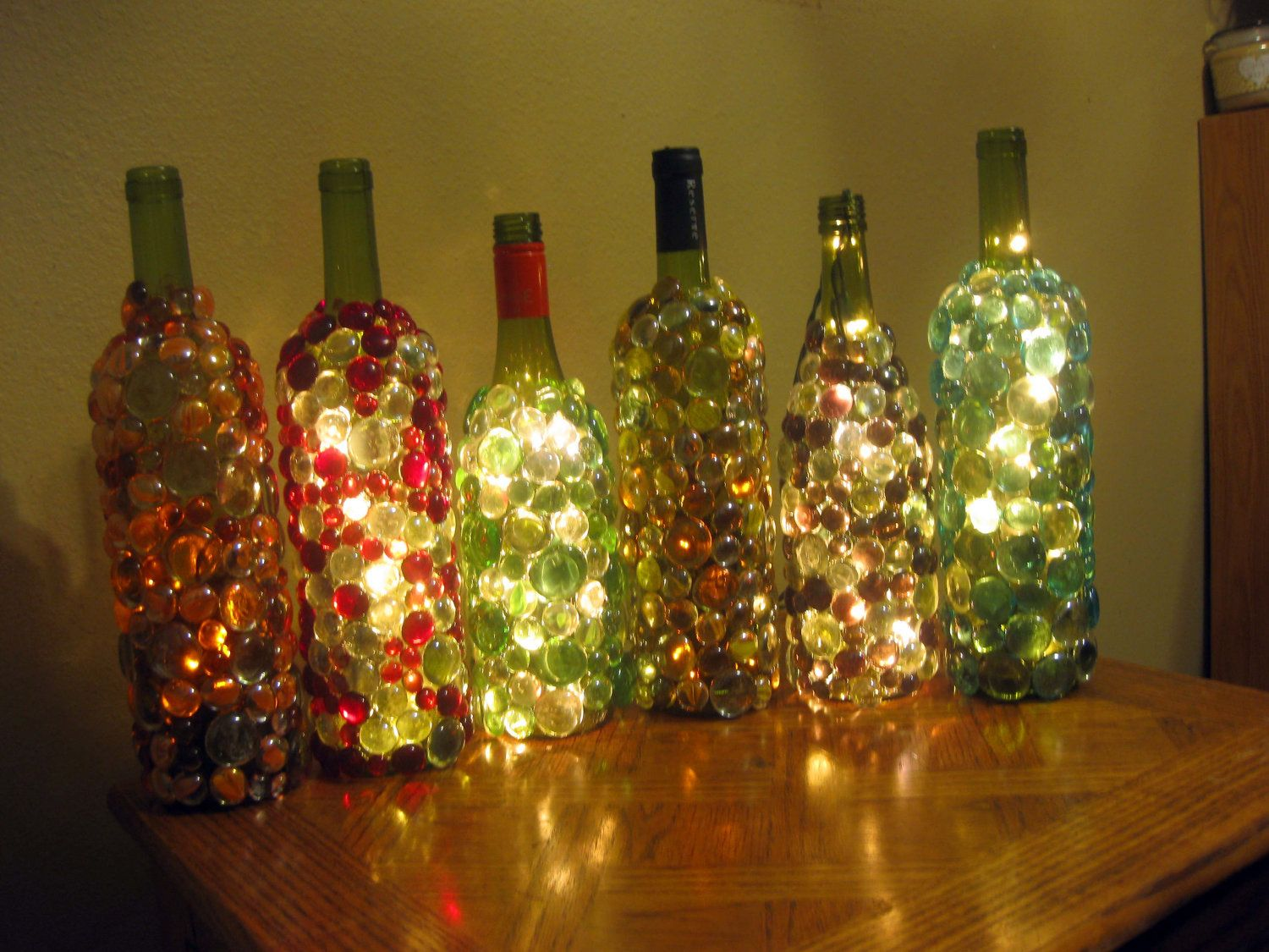 Glass gems glass gem embellished lighted wine bottles for How to make wine bottle lights