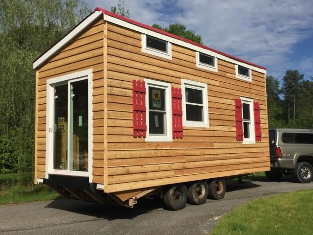 """The """"Chesterfield"""" Model from JPQ Construction Inc. is currently for sale for only $13,940. It is finished on the outside with cedar siding installed over Tyvek and OSB. It is constructed on a triple axle trailer and is registered and ready to tow away.It is at the """"shell"""" stage which means that it is unfinished…"""