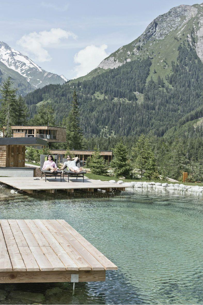 Gradonna Mountain Resort | Design Hotel | Austria | http://lifestylehotels.net/en/gradonna-mountain-resort-chalets-hotel | outside, view, mountain, alps, pond, lounger