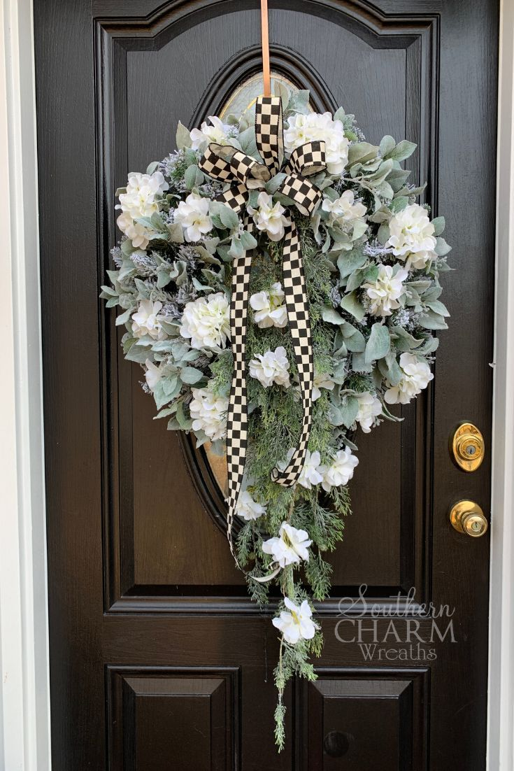 Learn to make stunning designer wreaths for your front door for a fraction of the cost to buy premade. This month, our wreath of the month club members learned to make a spectacular winter door wreath using fluffy hydrangeas and frosted veronica. #learntowreath #wreaths