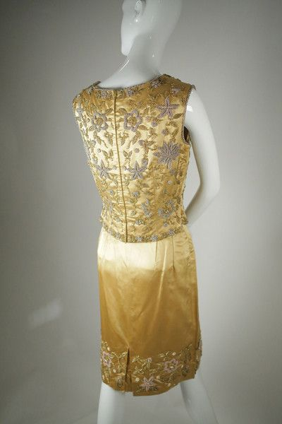Gold dutch silk satin set with elaborate hand-beading on both the bodice and the bottom hem of the skirt. Spectacular hand beading details with most luxurious materials used in its fabrication, its couture quality.