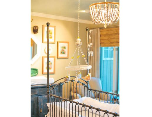 This vintage-style crib and chandelier add glamour to baby's space